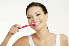 Woman  holding tooth brush Royalty Free Stock Images