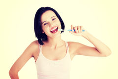 Woman with great teeth holding tooth brush Stock Photography
