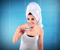 Woman with great teeth holding tooth-brush Royalty Free Stock Image