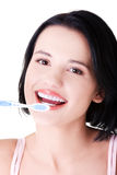 Woman with great teeth holding tooth-brush Stock Photo