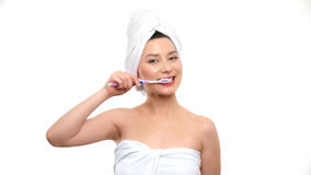 Woman with great teeth holding tooth-brush Royalty Free Stock Images