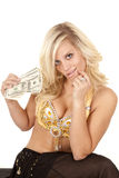 Woman greed genie hold money Royalty Free Stock Images