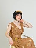Woman in a Greek dress Stock Image