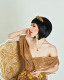 Woman in a Greek dress Royalty Free Stock Images
