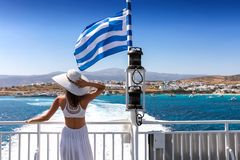 Woman on a Greek ferry boat traveling through the cyclades Royalty Free Stock Images
