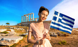 Woman with Greek flag on ancient ruins background Royalty Free Stock Photo