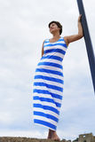 Woman in Greek flag dress Stock Image