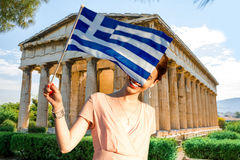 Woman with Greek flag on Hephaistos temple background Royalty Free Stock Image