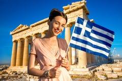 Woman with Greek flag on Parthenon background Stock Photos