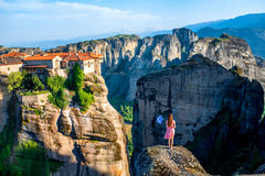 Woman with greek flag. Young woman in the pink dress with greek flag at the mountains near Meteora monasteries in Greece royalty free stock photography