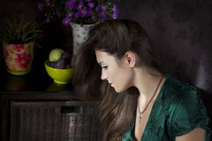 Woman in green. Portrait in profile of a girl in green dress Royalty Free Stock Image