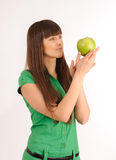 Woman with green apple. Royalty Free Stock Images