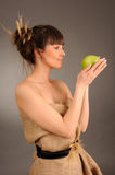 Woman with green apple. Royalty Free Stock Photos