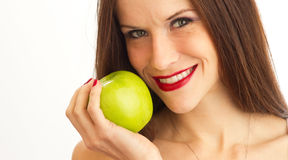 Woman Holds Green Apple Up to Smiling Face Stock Photos