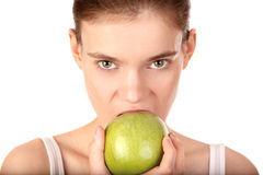 Woman with green apple royalty free stock photography