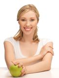 Woman with green apple Royalty Free Stock Image