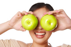 Woman green apple. Woman holding green apple in front of her eyes Stock Image