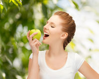 Woman with green apple at countryside Royalty Free Stock Images