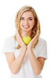 Woman with a green apple Royalty Free Stock Photography