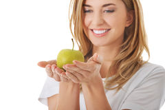 Woman with a green apple Royalty Free Stock Images
