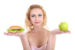 Woman with green apple and hamburger Royalty Free Stock Photography