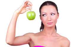 Woman with green apple in hand Stock Photo