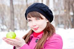 Woman  with a green apple in hands Royalty Free Stock Photography