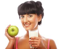 Woman with green apple and milk Stock Photography