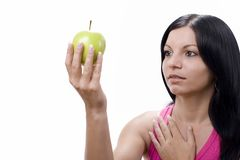 Woman with green apple over white Royalty Free Stock Photography