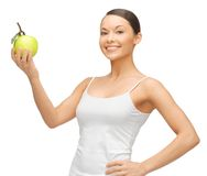 Woman with green apple Stock Photos