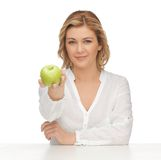 Woman with green apple Royalty Free Stock Photo