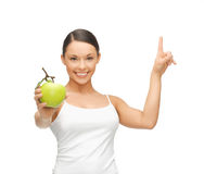Woman with green apple pointing her finger up Royalty Free Stock Photography