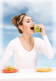 Woman with green apple and sandwich Stock Photography