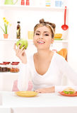 Woman with green apple and sandwich Royalty Free Stock Images