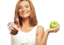 Woman with green apple and showing thumb up. Young woman with green apple and showing thumb up Stock Images