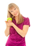 Woman with green apple smiling Stock Photo