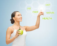 Woman with green apple and virtual screen Stock Photography