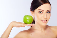 Woman with a green apple Stock Images
