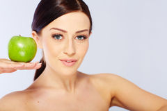 Woman with a green apple Stock Image