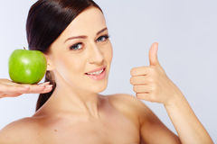 Woman with a green apple Royalty Free Stock Photos