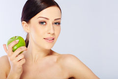 Woman with a green apple Stock Photography