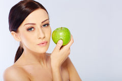 Woman with a green apple Royalty Free Stock Image