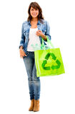 Woman with a green bag Royalty Free Stock Images