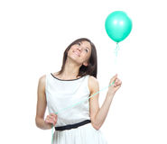 Woman with green balloon thinking Royalty Free Stock Photo