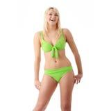 Woman in green bikini stock photography