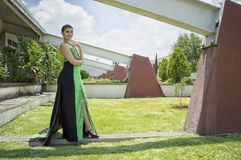 Woman in Green and Black Dress Standing in Front of Wall Royalty Free Stock Photos