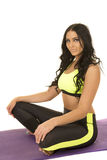 Woman in green and black fitness clothes sit relax Royalty Free Stock Image