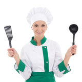 Woman in green chef uniform with kitchen tools isolated on white Royalty Free Stock Photos