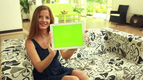 Woman with green chromakey tablet stock video footage