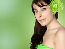 Woman with green chrysanthemum Royalty Free Stock Image